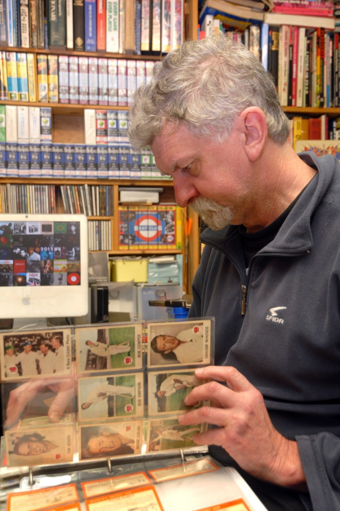 Collector Graeme Dickenson with one of his many albums of cricket cards.