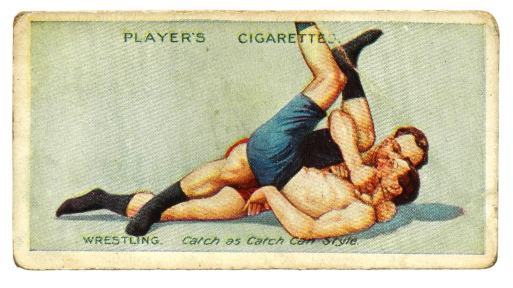 The Cradle Hold, No 8 in a series of 25 wrestling and ju-jitsu cards released by British cigarette company John Player & Sons in the 1930s.